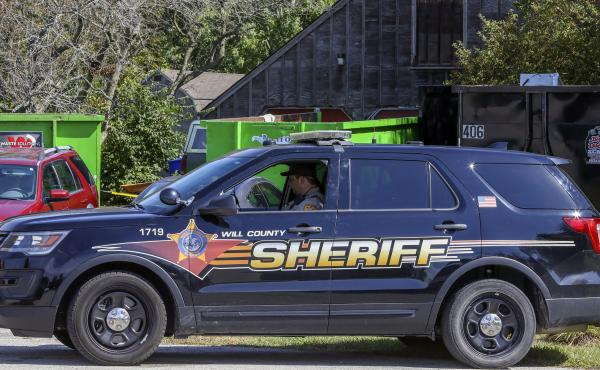 A patrol car is stationed outside the home of deceased Ulrich Klopfer in Crete, Ill., on Sept. 19, 2019. Indiana Attorney General Curtis Hill presided over the mass burial Wednesday of the remains of more than 2,400 fetuses found last year at the suburban