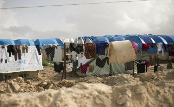 Laundry dries on a chain link fence in an area for foreign families of suspected ISIS fighters at al-Hol camp in Hassakeh province, Syria.