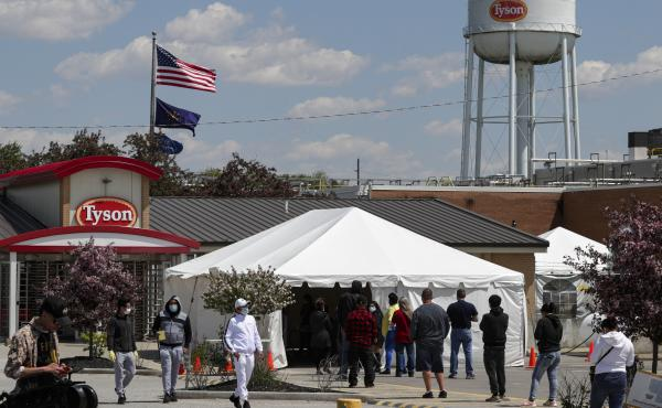 Workers line up to enter a Tyson Foods pork processing plant last month in Logansport, Ind. Some of the worst workplace coronavirus outbreaks have been in the meatpacking industry. Major meatpackers JBS USA, Smithfield Foods and Tyson have said worker saf