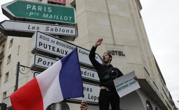 Protesters gathered in Paris on Saturday to oppose a requirement to use a health pass to enter businesses or use public transportation.
