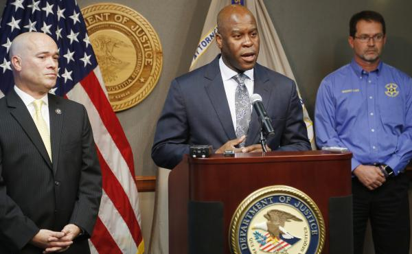 FBI Special Agent in Charge Eric Jackson announces the arrest of three members of a Kansas militia group that planned to bomb an apartment complex in Garden City, Kansas, where Somali families live. He is joined by Acting U.S. Attorney Tom Beall, left, Fr