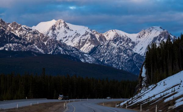 A truck travels along the Trans-Canada Highway at dusk in Banff National Park in 2017 in Alberta, Canada. Three climbers are presumed dead after an avalanche in the park.