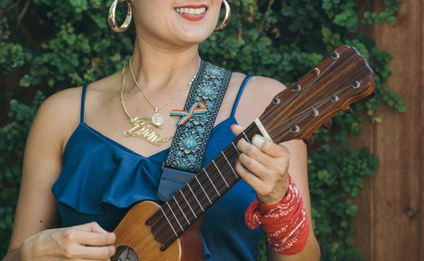 Denise Carlos of Las Cafeteras plays the jarana, a guitar-like string instrument from Mexico.