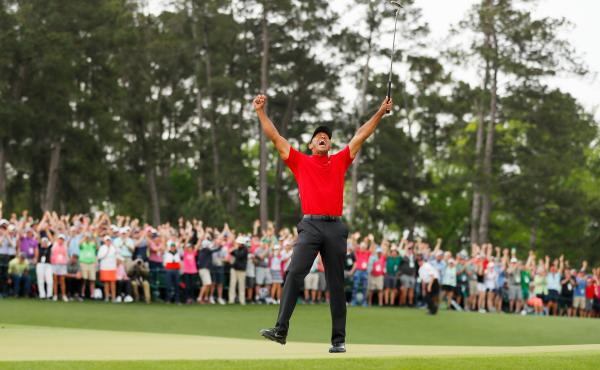 Tiger Woods celebrates after making his putt on the 18th green to win the Masters at Augusta National Golf Club on Sunday in Augusta, Georgia.