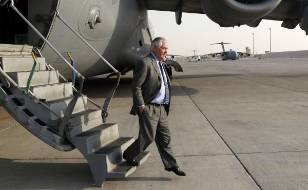 U.S. Secretary of State Rex Tillerson steps off the plane as he arrives in Qatar after returning from Bagram Air Base in Afghanistan on Monday. Tillerson paid a surprise visit to Afghanistan to meet with President Ashraf Ghani and other officials.