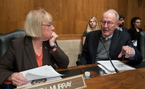 Sen. Patty Murray, D-Wash., the ranking member, and Sen. Lamar Alexander, R-Tenn., chairman of the Senate Health, Education, Labor, and Pensions Committee, meet before the start of a hearing on Capitol Hill in Washington, Wednesday, Oct. 18, 2017, the mor