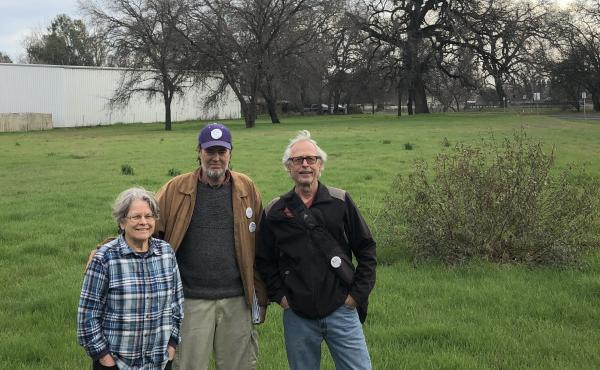 Chico Housing Action Team organizers Leslie Johnson, left, Charles Withuhn, center, and Bill Kurnizki, right, in the field in south Chico where they plan to soon break ground on a 33-unit tiny home community for homeless adults called Simplicity Village.