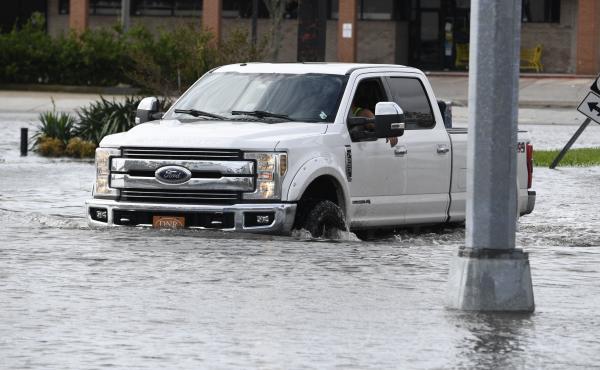 A truck in high water from Hurricane Ida near Highway 61 in Destrehan, Louisiana, on August 30, 2021.