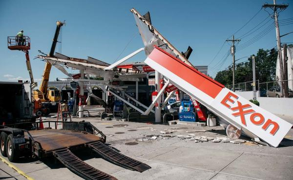 Workers clean a gas station damaged by the remnants of Hurricane Ida in New York City. Scientists warn that 60% of world oil reserves need to stay underground to avoid the worst impacts of climate change.
