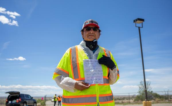 Navajo Nation President Jonathan Nez holds a letter from a Navajo family while distributing food, water and other supplies on May 27, on the Navajo Nation Reservation in New Mexico.