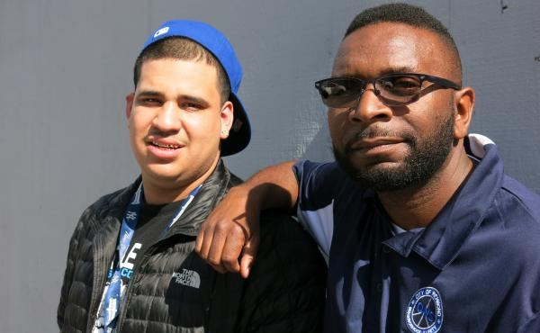 Joel Contreras, left, an Operation Peacemaker Fellow, and Joseph McCoy, a Neighborhood Change Agent with the Office of Neighborhood Safety, in Richmond, Cali. Fellows receive counseling, social services, a job and cash if they agree to stay in contact eve