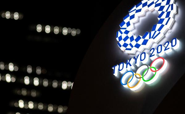 The Tokyo 2020 Olympic Games logo is pictured outside the Tokyo station in Tokyo on June 22.