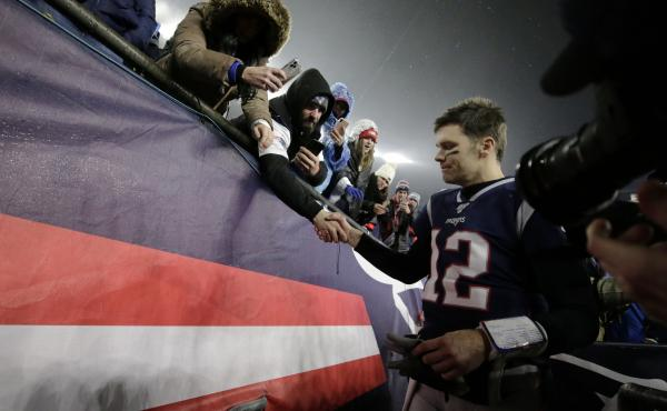 Tom Brady shakes hands with a fan as he leaves the field in Foxborough, Mass., after losing a playoff football game to the Tennessee Titans earlier this year. As it turns out, that was likely the final game the quarterback would play in a New England Patr