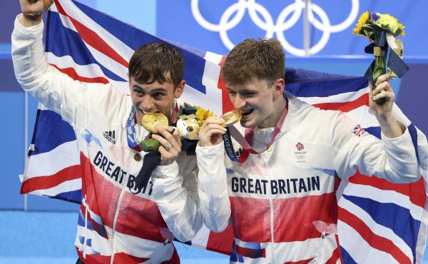 Tom Daley, left, and Matty Lee celebrate their win in the men's synchronized 10m platform final on day three of the Tokyo 2020 Olympic Games.