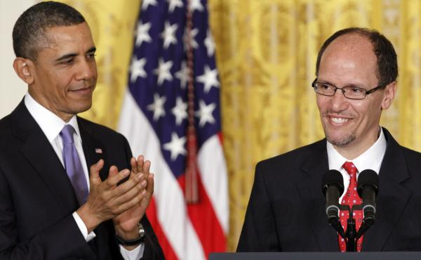 President Obama applauds Tom Perez in 2013, whom he nominated as labor secretary. Now, as the Obama presidency winds down, Perez is running for head of the Democratic National Committee.