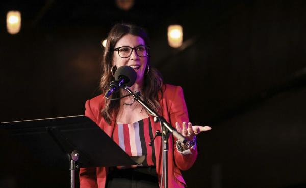 HQ Words host Anna Roisman leads a word game Ask Me Another at the Bell House in Brooklyn, New York.