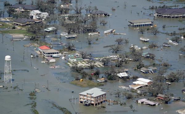 Buildings and homes were flooded after Hurricane Laura hit near Lake Charles, La., in August. Five named storms came ashore in Louisiana in 2020 — part of a record-setting Atlantic hurricane season.