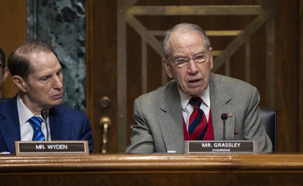 Senate Finance Chairman Chuck Grassley, R-Iowa, is joined by Sen. Ron Wyden, D-Ore., the ranking member, at a hearing on the high price of prescription drugs.