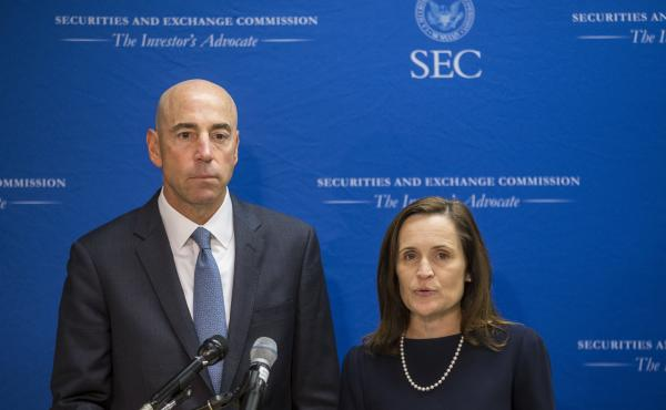 Securities and Exchange Commission Co-Directors of Enforcement Stephanie Avakian and Steven Peikin speak during a news conference in 2018. Avakian and Peikin say their office is aggressively pursuing enforcement related to the coronavirus pandemic.