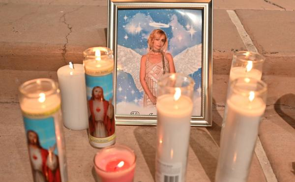 """Candles surround a photo of cinematographer Halyna Hutchins during a vigil on Oct. 23 in Albuquerque, New Mexico. The American Film Institute established a scholarship in honor of Hutchins, who was killed by a prop gun on the set of the movie """"Rust"""" last"""