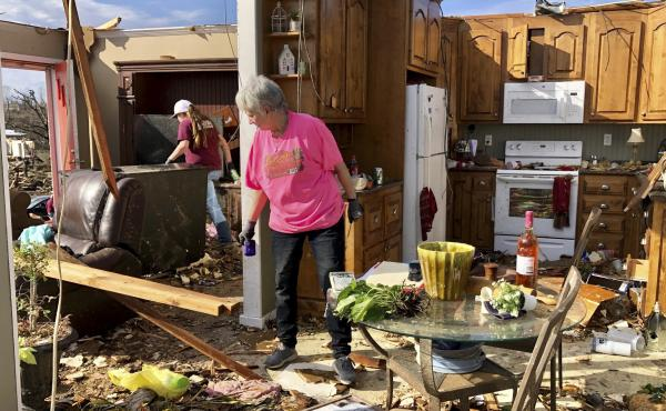 Patti Herring sobs as she sorts through the remains of her home in Fultondale, Ala., on Tuesday, after her house was destroyed by a tornado.