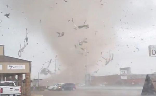 A screen grab from a social media video shows a tornado tearing through Jonesboro, Ark., on Saturday.