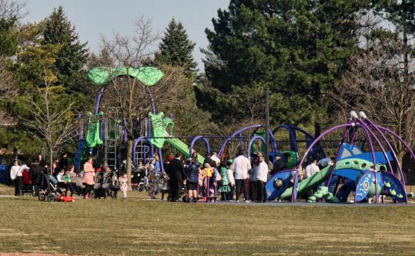 A crowd of parents and children at a playground during the COVID-19 pandemic in Toronto on April 4. Canada is experiencing a third wave of the coronavirus pandemic.