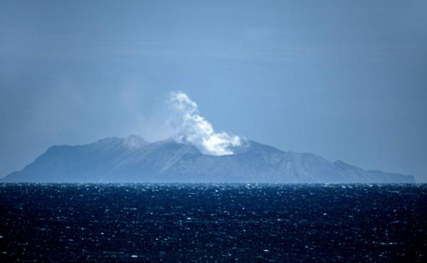 Steam rises from the volcano on New Zealand's White Island on Tuesday, one day after an eruption there left at least six people dead, more than 30 injured and still others missing. Questions linger about why so many people were allowed so close to the act