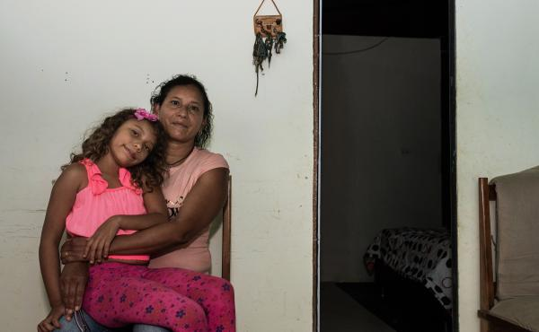 Lida María Urrego, here with her 7-year-old daughter Sofia, spent most of her life fighting with the FARC rebels. But since the signing of a 2016 peace treaty, she has been raising a family and guiding tourists near Mesetas.