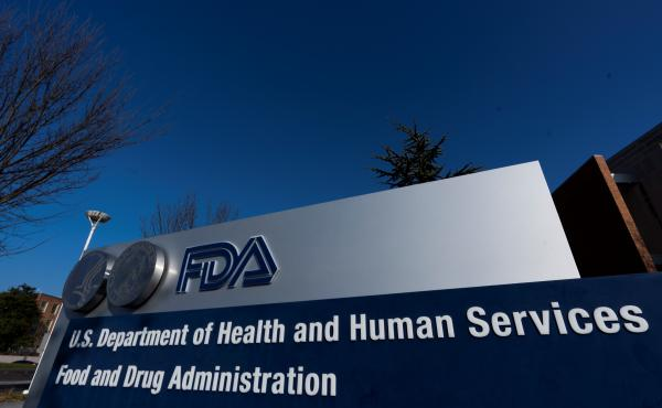 Food and Drug Administration building is shown Thursday, in Silver Spring, Md. A U.S. government advisory panel convened to decide whether to endorse emergency use of Pfizer's COVID-19 vaccine to help conquer the outbreak that has killed close to 300,000