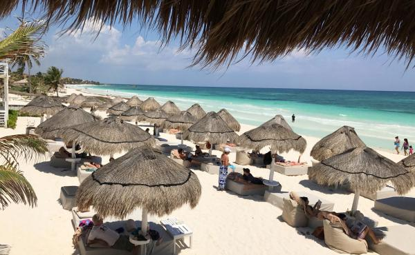 Tourists enjoy the beach in Tulum National Park in Mexico's Riviera Maya region. Some travelers have raised concerns about safety at some resorts in the region, including in a forum post on TripAdvisor this summer asking about blackouts and the risk of as