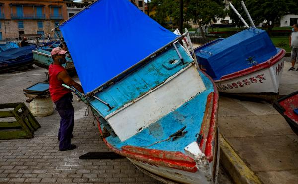 Fishermen secure their boats to land ahead of the passage of Tropical Storm Elsa in Havana, Cuba, on July 5. Elsa made landfall in Cuba and is now headed to Florida.