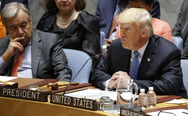"""Regrettably, we found that China has been attempting to interfere in our upcoming 2018 election — coming up in November — against my administration,"" President Trump said Wednesday at a meeting of the U.N. Security Council. Looking on is U.N. Secreta"