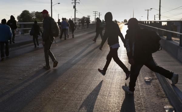 Members of the migrant caravan walk to make requests for political asylum at the U.S.-Mexico border last week in Tijuana, Mexico.