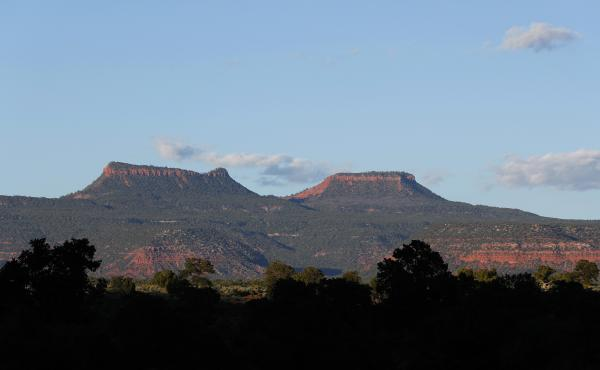The two bluffs that inspired the name of the Bears Ears National Monument, seen at sunset outside Blanding, Utah. On Thursday, more than two years after the Trump administration announced plans to shrink the monument and others, federal managers have fina