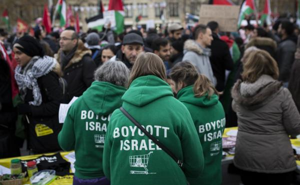 Demonstrators advocating the movement to boycott, divest from and sanction Israel, known as BDS, gather for a protest last year in Paris. On Thursday, U.S. Secretary of State Mike Pompeo announced a new policy specifically countering the global BDS campai