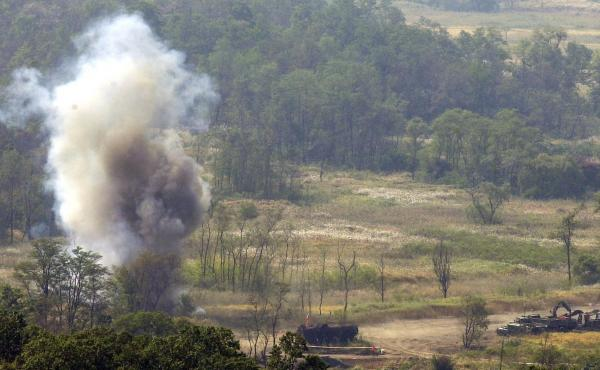 Smoke rises after South Korean soldiers set a blast to remove land mines in the Demilitarized Zone in 2002. The Korean Peninsula had been the last region the U.S. military was allowed to use the weapon — until Friday, when the Trump administration lifte