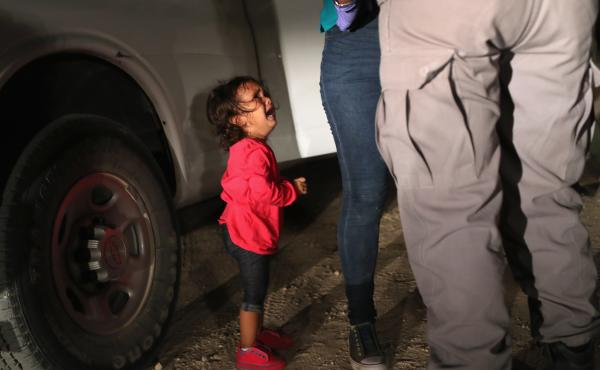A 2-year-old Honduran girl cries as her mother, who seeks asylum, is detained at the Southern border near McAllen, Texas, in June.