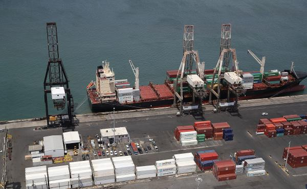 A container ship is seen docked at the port of San Juan as people deal with the aftermath of Hurricane Maria on Monday in San Juan, Puerto Rico.