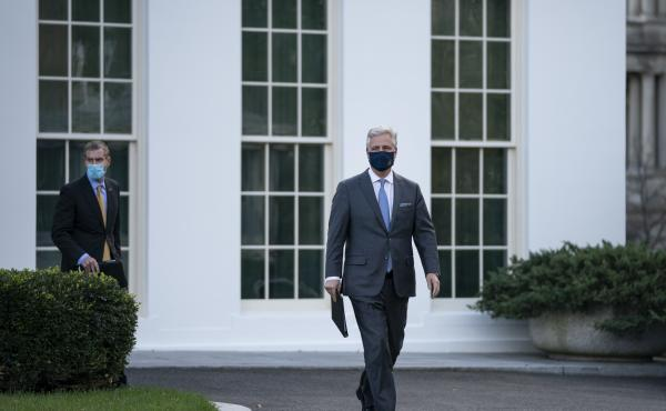 National security adviser Robert O'Brien arrives to speak to reporters outside the White House on Tuesday. O'Brien announced that President Trump has ordered 2500 U.S. troops to be withdrawn from Afghanistan and Iraq by Jan. 15.
