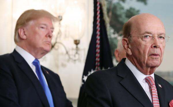 """President Trump listens as Commerce Secretary Wilbur Ross, who oversees the census, speaks at the White House. Ross approved including in the 2020 census the question, """"Is this person a citizen of the United States?"""""""