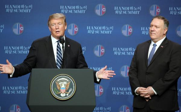 President Trump speaks as Secretary of State Mike Pompeo looks on during a news conference following the summit in Hanoi, Vietnam. Trump's second summit with Kim Jong Un collapsed Thursday without an agreement between the two leaders.