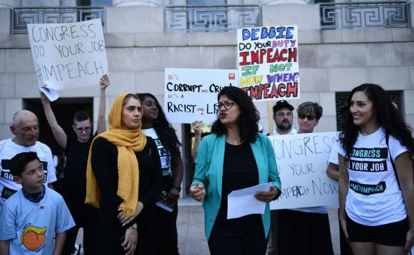 Rep. Rashida Tlaib, D-Mich., joins activists asking for impeachment of President Trump on Capitol Hill on Monday.