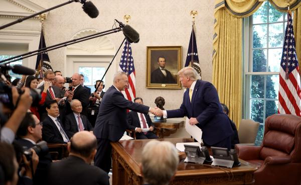 U.S. President Donald Trump shakes hands with Chinese Vice Premier Liu He in the Oval Office at the White House October 11, 2019 in Washington, DC. President Trump announced a 'phase one' partial trade deal with China.