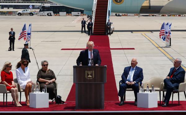 President Trump speaks at a welcome ceremony at Ben Gurion International Airport in Tel Aviv, Israel, on Monday, as Sara Netanyahu (from left), Melania Trump, Nechama Rivlin, Israeli President Reuven Rivlin and Israeli Prime Minister Benjamin Netanyahu li