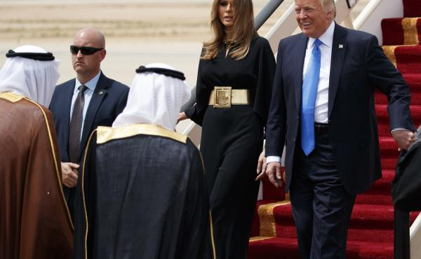 President Donald Trump, accompanied by first lady Melania Trump, smiles at Saudi King Salman, left, upon his arrival in Riyadh, Saudi Arabia.
