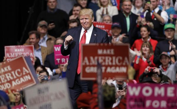 President Donald Trump acknowledges applause as he leaves the stage after speaking at a rally Wednesday in Nashville, Tenn.