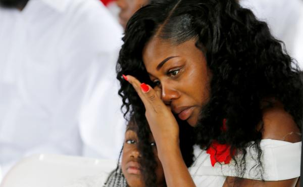 Myeshia Johnson, widow of U.S. Army Sergeant La David Johnson, who was among four special forces soldiers killed in Niger, sits with her daughter, Ah'Leeysa Johnson at a graveside service in Hollywood, Fla., on Oct. 21.