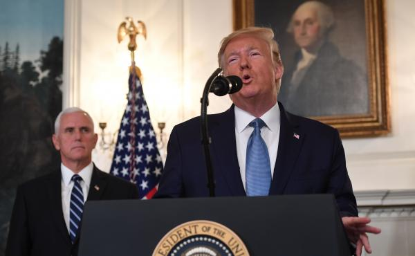 President Trump speaks about Syria in the Diplomatic Reception Room at the White House on Wednesday as Vice President Pence listens.