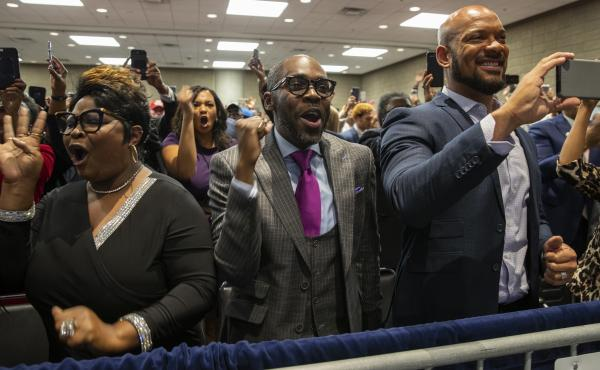 Supporters of President Trump cheer as he arrives to launch Black Voices for Trump at an Atlanta event.
